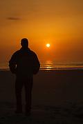 Silhouette of a man at Hampton Beach, New Hampshire at sunrise