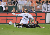 DC United midfielder Andy Najar (14) slides against Seattle Sounders goalkeeper Kasey Keller (18).  Seattle Sounders defeated DC United 1-0 at RFK Stadium, Thursday July 15, 2010.