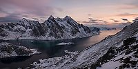 Himmeltindan mountain peaks rise over Steinsfjord in winter, Vestvågøy, Lofoten Islands, Norway