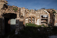 Onna, a few Kilometres from L'Aquila, is a village that was almost completely erased by the earthquake of April 6, 2009.  85% of its old buildings went destroyed, killing 40. <br /> The ruins of a house are converted into a memorial of the victims fell under the rubble.  Onna, Italy. April 10, 2015