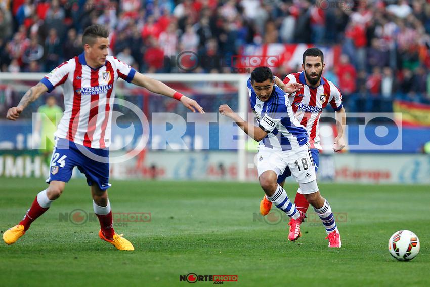 Atletico de Madrid´s Gimenez and Arda Turan and Real Sociedad´s Chory Castro during La Liga match at Vicente Calderon stadium in Madrid, Spain. April 07, 2015. (ALTERPHOTOS/Victor Blanco) /NORTEphoto.com