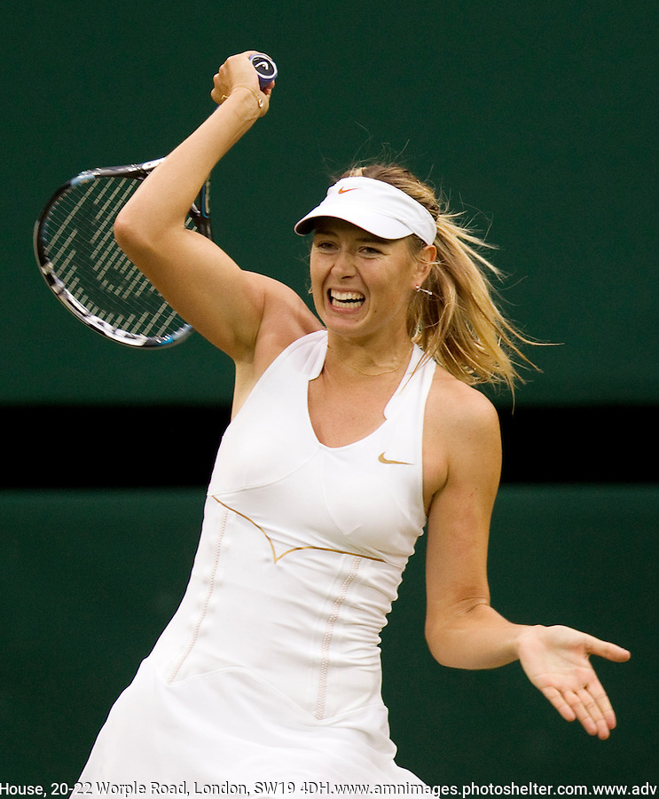 MARIA SHARAPOVA (RUS) (5) against DOMINIKA CIBULKOVA (SVK) (24) in the Quarter Finals of the Ladies Singles. Maria Sharapova beat Dominika Cibulkova 6-1 6-1..Tennis - Grand Slam - Wimbledon - AELTC - London- Day 08 - Tue June 28th  2011..© AMN Images, Barry House, 20-22 Worple Road, London, SW19 4DH, UK..+44 208 947 0100.www.amnimages.photoshelter.com.www.advantagemedianetwork.com.