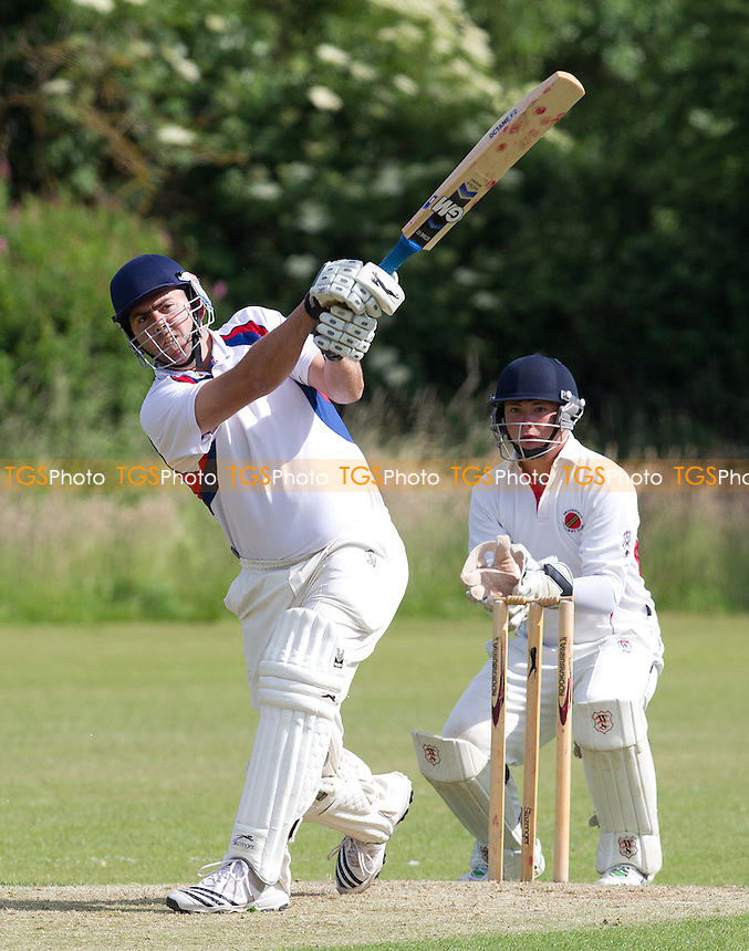Anton Nortje of Hornchurch Athletic clears the rope  - Broomfield CC v Hornchurch Athletic CC - Essex Cricket League - 29/06/13 - MANDATORY CREDIT: Ray Lawrence/TGSPHOTO - Self billing applies where appropriate - 0845 094 6026 - contact@tgsphoto.co.uk - NO UNPAID USE