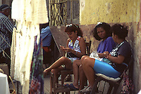 women at work along the street Trinidad in  Cuba