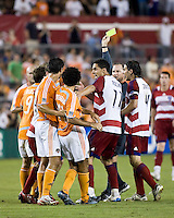 Referee Kevin Scott shows a yellow card caution to FC Dallas midfielder Marcelo Saragosa (5) in the 82nd minute for holding on Houston Dynamo forward Dwayne De Rosario (14).  FC Dallas midfielder Andre Rocha (11), FC Dallas defender Duilio Davino (4), Houston Dynamo forwards Dwayne De Rosario (14) and Brian Ching (25) and Houston Dynamo midfielder Brian Mullan (9) react to the play and subsequent card.   Houston Dynamo and FC Dallas played to a 1-1 tie at Robertson Stadium in Houston, TX on June 26, 2008.