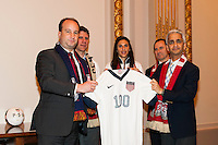 U.S. Soccer president Sunil Gulati (right) presents Stefhan Jekel, managing director of EMEA with a US Soccer jersey during the centennial celebration of U. S. Soccer at the New York Stock Exchange in New York, NY, on April 02, 2013.