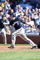 Milwaukee Brewers third baseman Mark Reynolds (7) hits a home run during a game against the Chicago Cubs on August 14, 2014 at Wrigley Field in Chicago, Illinois.  Milwaukee defeated Chicago 6-2.  (Mike Janes/Four Seam Images)