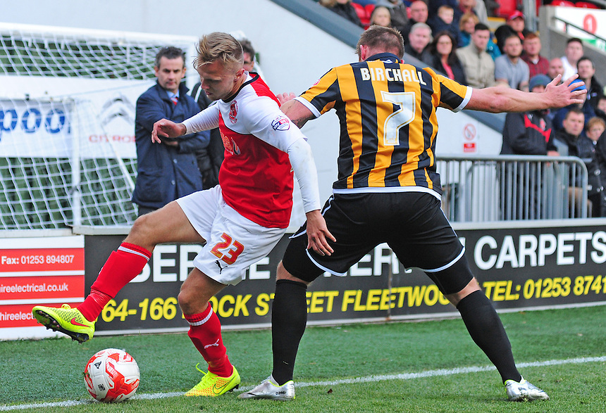 Fleetwood Town's David Ball vies for possession with Port Vale's Chris Birchall<br /> <br /> Photographer Chris Vaughan/CameraSport<br /> <br /> Football - The Football League Sky Bet League One - Fleetwood Town v Port Vale - Saturday 04th October 2014 - Highbury Stadium - Fleetwood<br /> <br /> &copy; CameraSport - 43 Linden Ave. Countesthorpe. Leicester. England. LE8 5PG - Tel: +44 (0) 116 277 4147 - admin@camerasport.com - www.camerasport.com