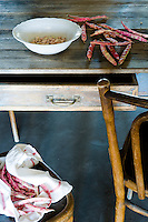 Detail of fresh borlotti beans on a rustic wooden table