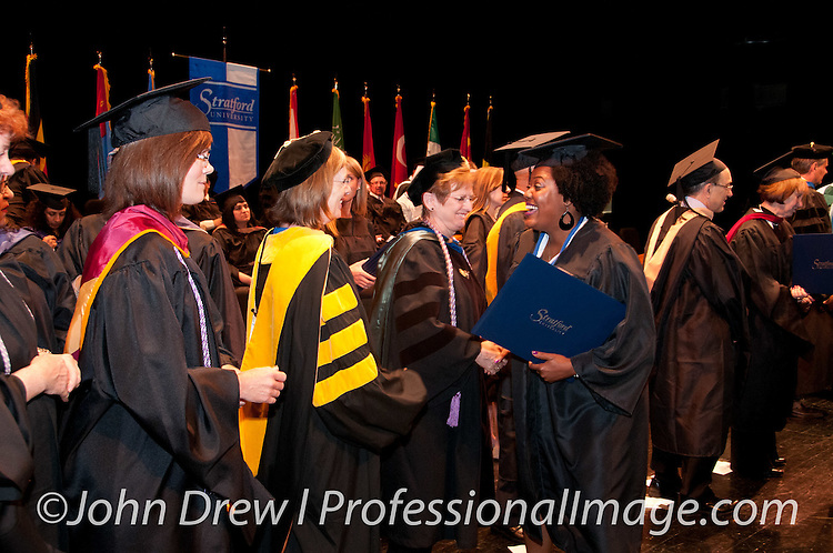 Stratford University Graduation - George Mason University on June 7, 2014.<br /> <br /> Photos by &copy;Professional Image 2014 c/o Professional Image Photography - www.professionalimage.com for Rates, Info &amp; Availability.  Twitter.com/Profimagephoto #corporatephotography, #photographerdc #Stratford,