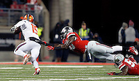 Ohio State Buckeyes defensive lineman Jalyn Holmes (10) just  misses Illinois Fighting Illini quarterback Aaron Bailey (15) in the third quarter of the NCAA football game at Ohio Stadium on Saturday, November 1, 2014. (Columbus Dispatch photo by Jonathan Quilter)