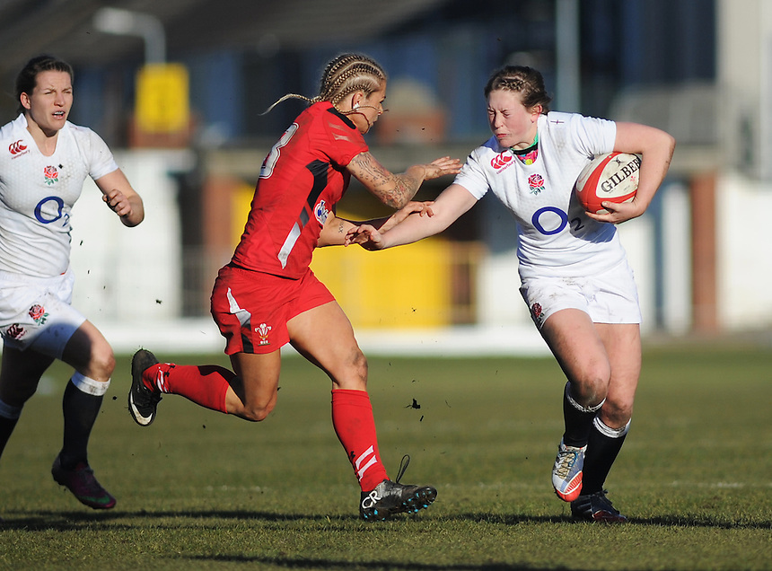 England Women's Megan Goddard under pressure from Wales Women's Adi Taviner<br /> <br /> Photographer Kevin Barnes/CameraSport<br /> <br /> International Womens Rugby Union - 2015 RBS 6 Nations Championship - Wales Women v England Women - Sunday 8th February 2015 - St Helen's - Swansea<br /> <br /> &copy; CameraSport - 43 Linden Ave. Countesthorpe. Leicester. England. LE8 5PG - Tel: +44 (0) 116 277 4147 - admin@camerasport.com - www.camerasport.com