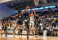 WASHINGTON, DC - FEBRUARY 22: Armel Potter #2 of George Washington goes up for a shot between Ayinde Hikim #0 and Sherif Kenney #4 of La Salle during a game between La Salle and George Washington at Charles E Smith Center on February 22, 2020 in Washington, DC.