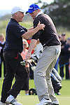 Final Day of the 100th Irish PGA championship at Seapoint Golf Club, Co Louth..David Mortimer celebrating after sinking his putt to win celebrates with caddy with John Freiser who also caddied for him in 2006 when he last won the Irish PGA..Picture Fran Caffrey/www.golffile.ie.