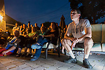 "Merrick, New York, USA. 11th June 2017.  ""American Grit"" TV contestant CHRIS EDOM (wearing white  GOT GRIT? T-shirt), 48, of Merrick, hosts backyard Viewing Party for Season 2 premiere. Edom family relatives and neighbors watched Episode 1 of FOX network reality television series that Sunday night outdoors. Edom was last contestant picked for a team that episode."