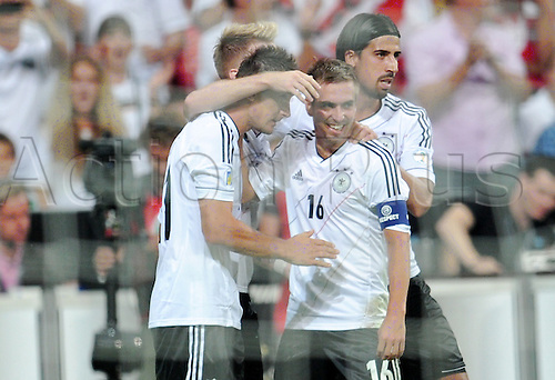 06.09.2013. Allianz Arena, Munich, Germany.  Germany's Miroslav Klose (L-R) celebrates with team-mates Marco Reus, Philipp Lahm and Sami Khedira after scoring the opening goal during the FIFA World Cup 2014 qualification group C soccer match between Germany and Austria .