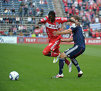 New England defender Chris Tierney (8) tries to hold up Chicago forward Patrick Nyarko (14).  The Chicago Fire defeated the New England Revolution 3-2 at Toyota Park in Bridgeview, IL on Sept. 25, 2011.