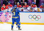 (R) Erik Karlsson of Sweeden celebrates with (L) Oliver Ekman-Larsson of Sweden during the match between Sweden vs Czech Republic during their Men's Ice Hockey Preliminary Round Group C game on day five of the 2014 Sochi Olympic Winter Games at Bolshoy Ice Dome on February 12, 2014 in Sochi, Russia. Photo by Victor Fraile / Power Sport Images