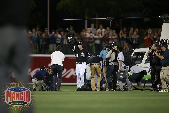 GLENDALE, AZ - MARCH 12:  Actor Will Ferrell of the Chicago White Sox lands in centerfield in a helicopter during a spring training game against the San Francisco Giants at Camelback Ranch on March 12, 2015 in Glendale, Arizona. (Photo by Brad Mangin)