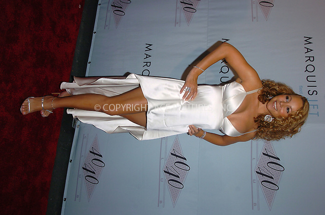 Mariah Carey sporting a scar on her right knee and a red kabbalah wrist band on her left arm as she arrives at the party to celebrate second anniversary of Club 40/40. New York, June18, 2004. Please byline: AJ SOKALNER/ACE Pictures.   .. *** ***..All Celebrity Entertainment, Inc:  ..contact: Alecsey Boldeskul (646) 267-6913 ..Philip Vaughan (646) 769-0430..e-mail: info@nyphotopress.com