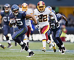 Seattle Seahawks wide receiver Doug Baldwin runs away from Washington Redskins corner back Kevin Barnes in the Seattle Seahawks 17-23 loss to the Redskins at  CenturyLink Field in Seattle, Washington on November 27, 2011. Seattle Seahawks 17-23 loss to the Redskins. ©2011 Jim Bryant Photo. All Rights Reserved.