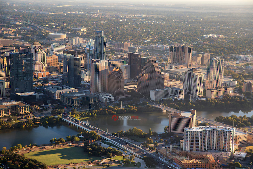 Aerial panoramic view of the Austin Skyline and Lady Bird Lake from a helicopter as Austin, Texas tops the annual list of fastest growing cities in the United States.