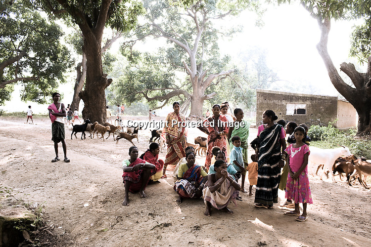 Local Kondh villagers sit next to the makeshift gate that has been set up by the villagers to stop Vedanta officials to go across to the proposed area for mining in the Niyamgiri hill is seen in Lanjigarh, Orissa.