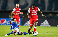 BOGOTA, COLOMBIA - MARCH 03: Dairon Mosquera of Santa Fe fights for the ball against David Silva of Millonarios during the match between Millonarios and Independiente Santa Fe as part of the Liga BetPlay at Estadio El Campin on March 3, 2020 in Bogota, Colombia. (Photo by VIEW press/Getty Images)