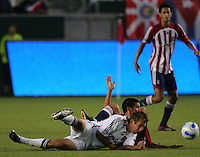 Chivas USA midfielder Paulo Ngagmura (26) gets tangled up with Real Salt Lake midfielder Carey Talley (3). CD Chivas USA beat Real Salt Lake 1-0 in a MLS game at the Home Depot Center in Carson, California, Sunday, August 26, 2007.