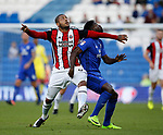 Leon Clarke of Sheffield Utd tussles with Bruno Ecuele Manga of Cardiff City during the Championship match at the Cardiff City Stadium, Cardiff. Picture date: August 15th 2017. Picture credit should read: Simon Bellis/Sportimage