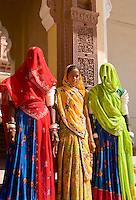 Jodhpur at Fort Mehrangarh in Rajasthan India.  Women in saris in doorway of Fort Palace