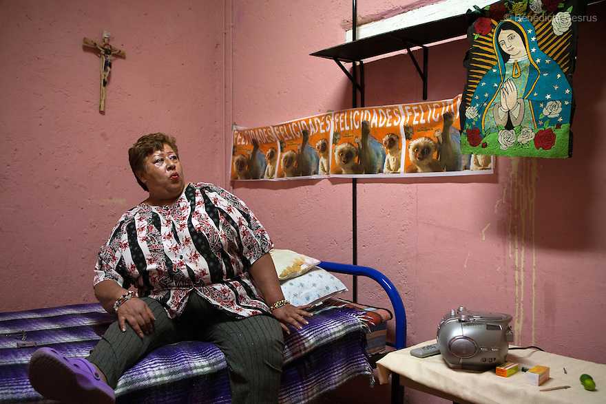 Lourdes, a resident of Casa Xochiquetzal, in her bedroom at the shelter in Mexico City, Mexico on February 19, 2009. Casa Xochiquetzal is a shelter for elderly sex workers in Mexico City. It gives the women refuge, food, health services, a space to learn about their human rights and courses to help them rediscover their self-confidence and deal with traumatic aspects of their lives. Casa Xochiquetzal provides a space to age with dignity for a group of vulnerable women who are often invisible to society at large. It is the only such shelter existing in Latin America. Photo by Bénédicte Desrus