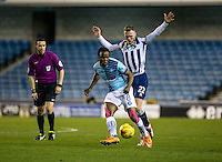 Marcus Bean of Wycombe Wanderers and Aiden O'Brien of Millwall during the Checkatrade Trophy round two Southern Section match between Millwall and Wycombe Wanderers at The Den, London, England on the 7th December 2016. Photo by Liam McAvoy.