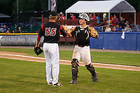 Batavia Muckdogs relief pitcher Steven Farnworth (55) celebrates with catcher Korey Dunbar (43) after a game against the Mahoning Valley Scrappers on June 24, 2015 at Dwyer Stadium in Batavia, New York.  Batavia defeated Mahoning Valley 1-0 as Gabriel Castellanos, Brett Lilek and Farnworth combined on the organizations first perfect game in team history.  (Mike Janes/Four Seam Images)