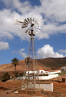 Working windmill pumping water, in typical canarian village, Fuerteventura, Canary Islands, Spain.