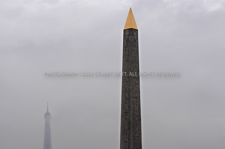 12/3/2003--Paris, France..The 3200 year old obelisk from Luxor Egypt which was presented as a gift to King Louis-Philippe and now stands in the Place de la Concorde in central Paris...All photographs ©2003 Stuart Isett.All rights reserved.This image may not be reproduced without expressed written permission from Stuart Isett.