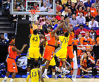 Players from both sides go after the rebound. Syracuse defeated Marquette 55-39 during the NCAA East Regional Final at the Verizon Center in Washington, D.C. on Saturday, March 30, 2013. Alan P. Santos/DC Sports Box