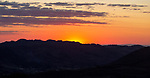 Sunset with glowing sky orange sun dropping behind hills. Photo taken looking south west from Marvao, Portalegre district, Alto Alentejo, Portugal, Southern Europe