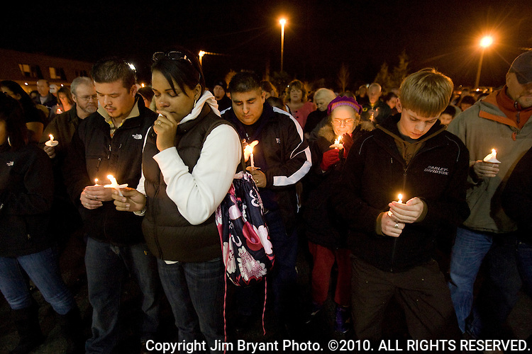 Stephanie James, front,  grieves during a light prayer vigil at the Champion's Centre in Tacoma WA., for family members, friends and law enforcement officers for four Lakewood Police officers killed at a Lakewood coffee shop on Sunday, Nov. 29, 2009.  At about 8:00 a.m. Sunday morning, a gunman walked into the Forza Coffee shop and while the four police officers were having coffee before their shift started, he opened fire, killing all four law enforcement officers. James, who's husband is also a Lakewood poice officer knew the police officers killed. Jim Bryant Photo. ©2010. ALL RIGHTS RESERVED.