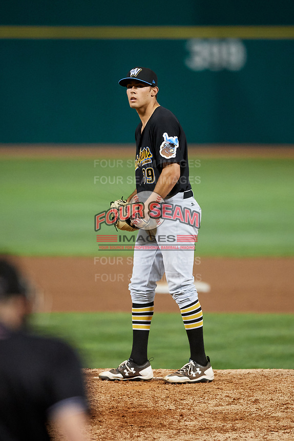 West Virginia Black Bears relief pitcher Allen Montgomery (39) gets ready to deliver a pitch during a game against the State College Spikes on August 30, 2018 at Medlar Field at Lubrano Park in State College, Pennsylvania.  West Virginia defeated State College 5-3.  (Mike Janes/Four Seam Images)