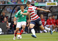 MEXICO CITY, MEXICO - AUGUST 15, 2012:  Geoff Cameron (20) of the USA MNT cuts off Javier (Chicharito) Hernandez (14) of  Mexico during an international friendly match at Azteca Stadium, in Mexico City, Mexico on August 15. USA won 1-0.