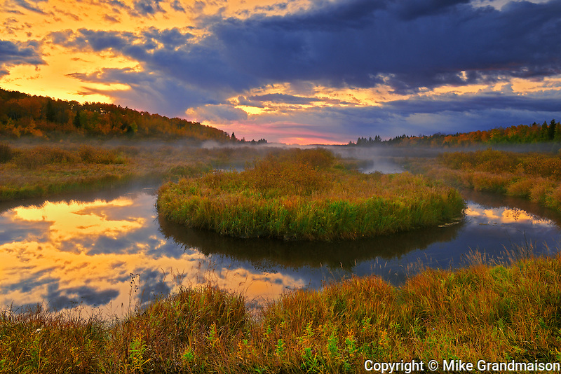 Dawn sky reflects in Sppuce River in autumn<br /> Prince Albert National Park<br /> Saskatchewan<br /> Canada