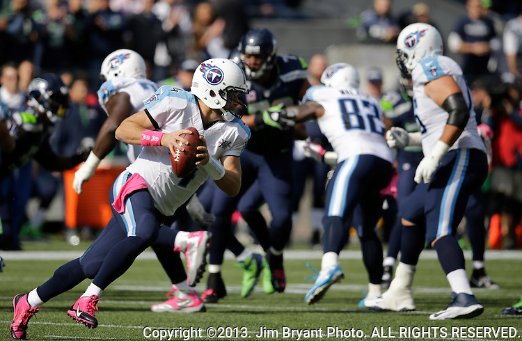 Tennessee Titians quarterback Ryan Fitzpatrick looks to pass against the Seattle Seahawks at CenturyLink Field in Seattle, Washington on October 13, 2013. The Seattle Seahawks beat the Titians  20-13.   ©2013. Jim Bryant Photo. All Rights Reserved.