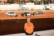 October 20, 2012. Raleigh, North Carolina.. A crew member watches his car in the 2012 North Carolina State Fair figure eight races. The races were judged in 2 qualifying heats of 8 laps and then the qualifiers competed in a 10 lap finale..