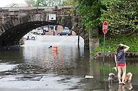 MAMARONECK, NY - AUGUST 28: A local resident surveys flood waters under the Metro-North right-of-way on Jefferson Street in the Village of Mamaroneck, New York on Sunday August 28, 2011 in the aftermath of Hurricane Irene.
