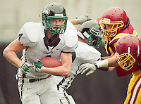 Peninsula Junior Danny Welstad (4) runs the ball upfield at Memorial Stadium in Seattle, Washington, on Saturday, November 6, 2010. O'Dea won the game 21-7.