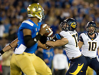 Kyle Kragen of California puts a lot of pressure on UCLA quarterback Brett Hundley during the game at Rose Bowl in Pasadena, California on October 12th, 2013.   UCLA defeated California, 37-10.