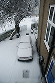 Car covered in snow in a driveway
