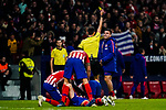 Angel Correa of Atletico de Madrid gets the yellow card as Diego Roberto Godin Leal of Atletico de Madrid celebrates  with teammates scoring the goal during the La Liga 2018-19 match between Atletico de Madrid and Athletic de Bilbao at Wanda Metropolitano, on November 10 2018 in Madrid, Spain. Photo by Diego Gouto / Power Sport Images