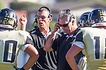 Palos Verdes, CA 09/27/13 - Michael Christensen (Peninsula Head Coach) and Doug Esparza (Peninsula Coach) in action during the Lawndale vs Palos Verdes Peninsula Varsity football game at Peninsula High School.